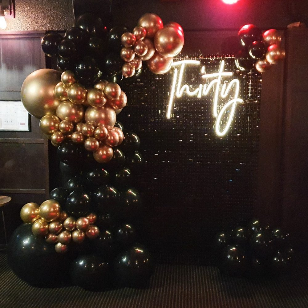 Gatsby Themed Backdrop Black Shimmer Wall with Black and Chrome Gold Garland